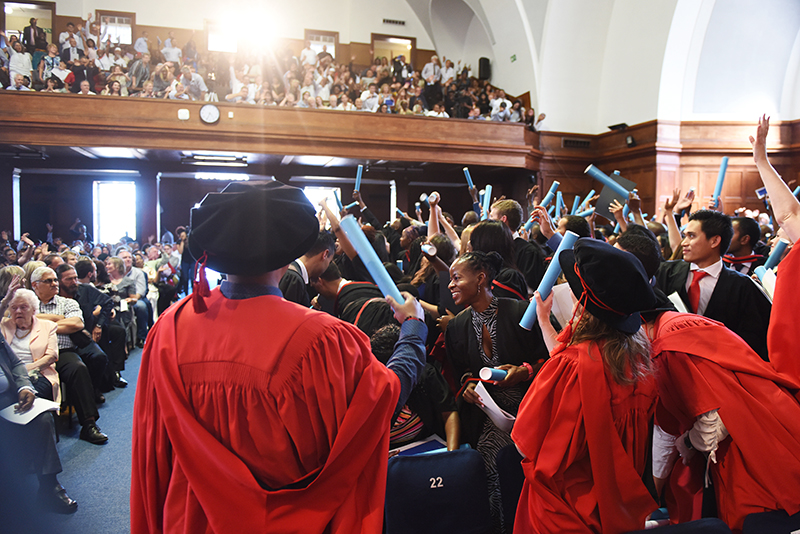 Newly capped graduands celebrate their success at the Faculty of Health Sciences graduation ceremony on Wednesday 20 December.