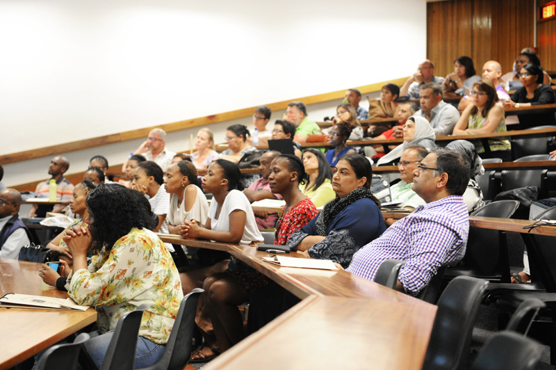 Parents listen intently during a talk by the deans of the faculties.