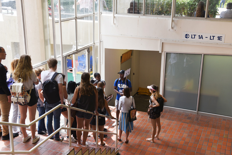 A campus tour group makes a pit stop in the Leslie Social Science building.