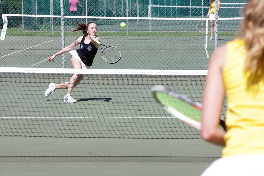 UCT's Gemma Alcock in action on the tennis court against Stellenbosch University opponent Jane Gerber.