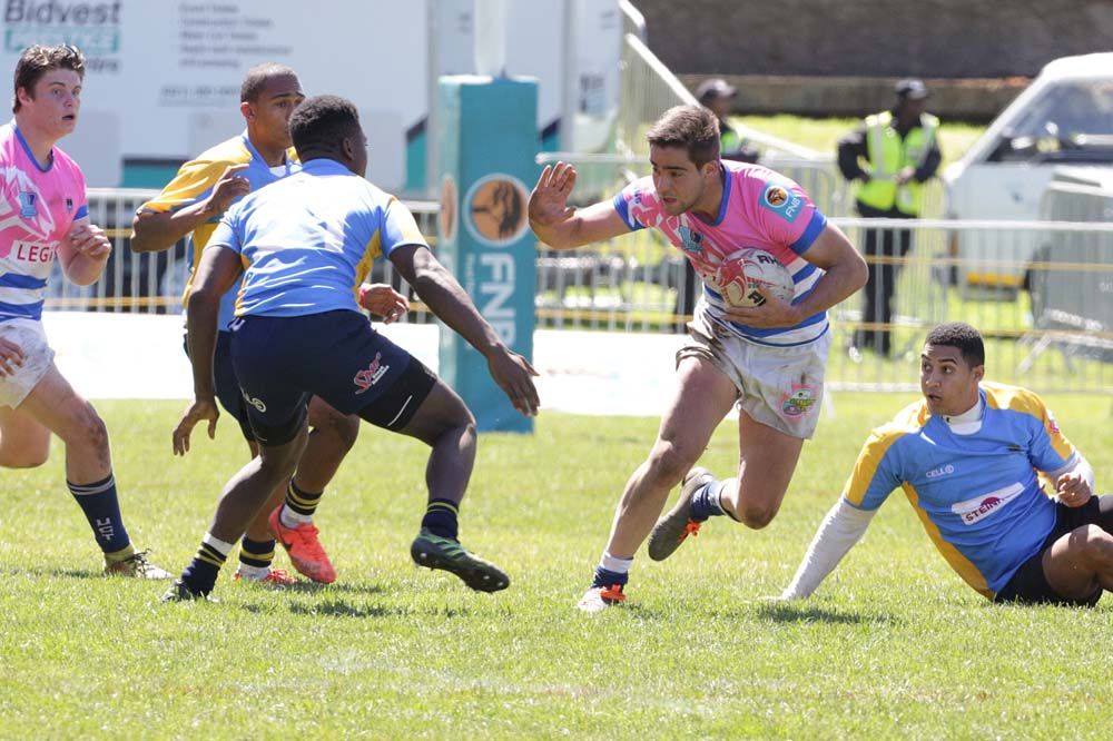 UCT rugby sevens players make sure to ward off the opposition in any way possible They ultimately went down to Stellenbosch University.