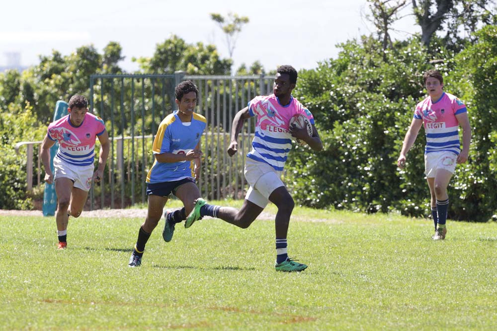 Grit and determination on the faces of UCT seven rugby players as they outrun their competition.