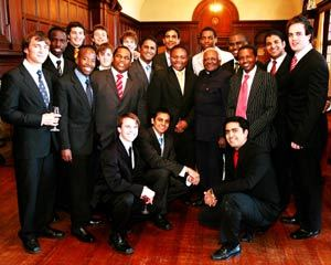 Happy moments: Archbishop Emeritus Desmond Tutu with some of the Smutsmen during a lunch to celebrate Smuts Hall's 80th birthday.