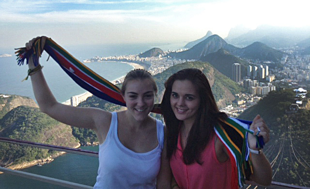 Field study: BBusSci (marketing) students Julia Cassar (left) and Chesney Sneyd at the top of Sugarloaf Mountain in Rio de Janeiro, Brazil, where they are gathering data on the FIFA World Cup for a project on safety and security at mega events and its affects on tourists' perceptions of the host country.