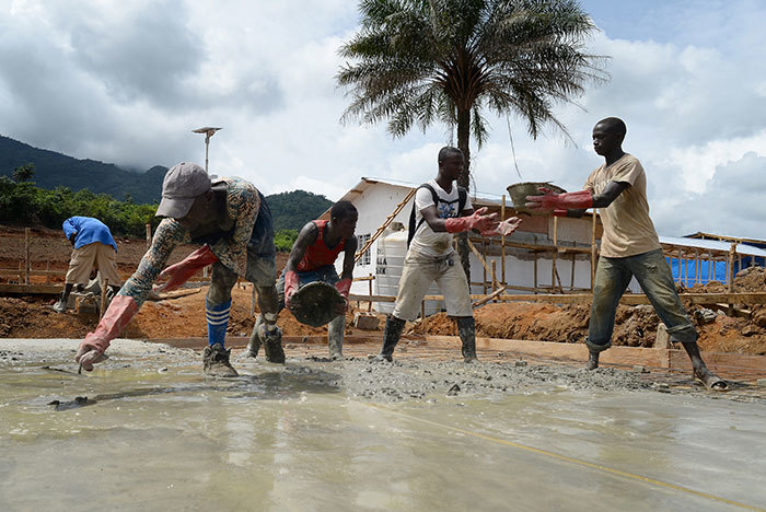Local builders working on the construction of a new UK Ebola Treatment Unit in Kerry Town in Sierra Leone.