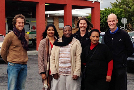 Pictured outside the GF Jooste Hospital, the South African site of the Cryptococcal Optimal Antiretroviral Timing Trial are from left: Friedrich Thienemann, Amy Nair, Yolisa Sigila, Charlotte Schutz, Monica Magwayi and Assoc Prof Graeme Meintjes. The team conducted the South African part of the collaborative study into when to start antiretroviral therapy following treatment for fungal meningitis.