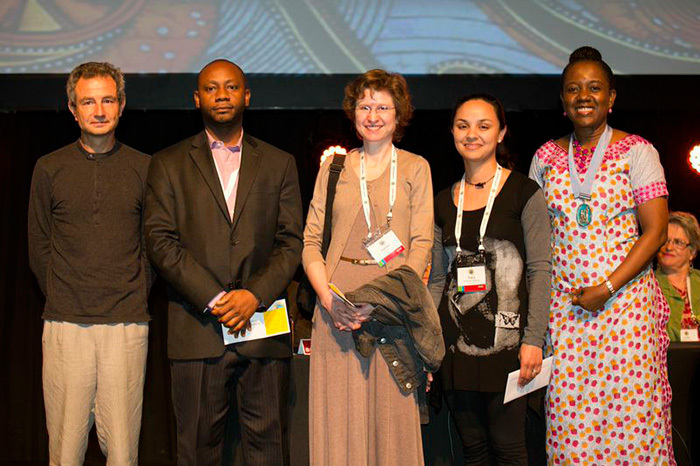 From left to right: Prof Bruno Falissard (France), President of IACAPAP, Dr Jibril Abdulmalik (Nigeria, 3rd prize), Lauren Wild (UCT, 1st prize with Fairuz Gabie), Tracy McClinton-Apollis (UCT, 2nd prize), Prof Olayinka Omigbodun (Nigeria), Past President of IACAPAP