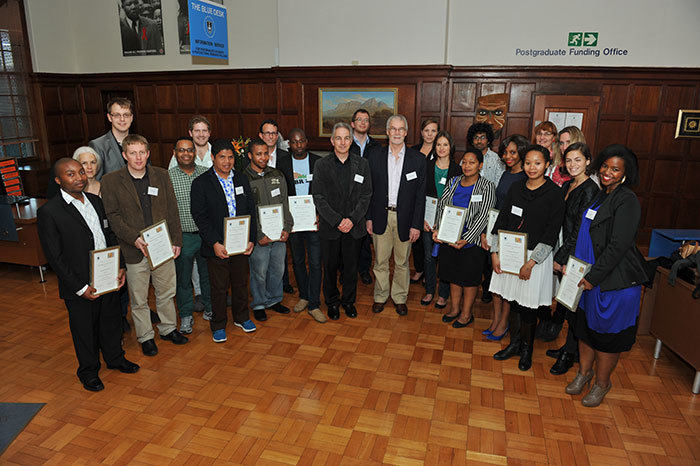 Vice-Chancellor Dr Max Price and Deputy Vice-Chancellor Prof Danie Visser (middle) congratulate the postgraduate students and their supervisors who received Research Associateship Awards.
