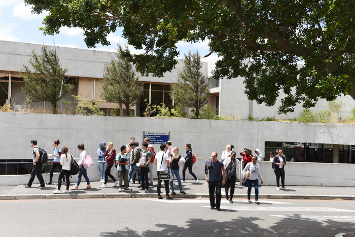 Students leave UCT's sports centre after writing their PGDA exam.