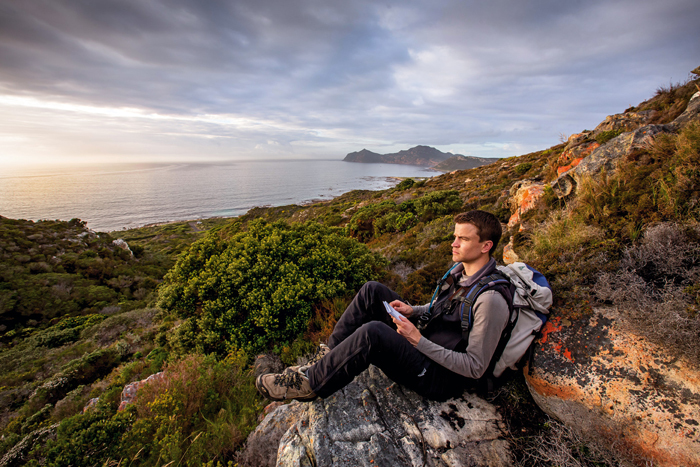 Free from the sea: PhD researcher Matthew Lewis observes the Kanonkop baboon troop foraging for seafood at the Cape Point Nature Reserve. Lewis was one of 86 UCT doctoral students who graduated in June 2015. His supervisor was Prof Justin O'Riain in the Department of Biological Sciences.