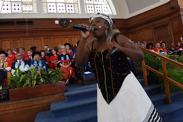The imbongi at Saturday morning's graduation raining praise on the university's graduands. Sange is a third-year African music student at UCT.