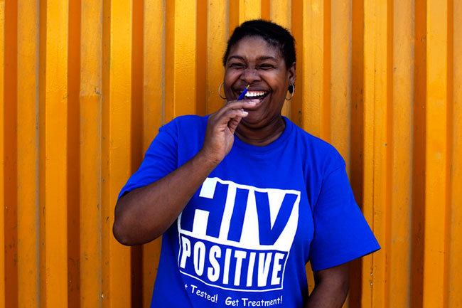 HIV positive T-shirts have been distributed to reduce the stigma attached to the disease. This would have been unthinkable 30 years ago. (Photo by Finbarr O'Reilly/Reuters.)