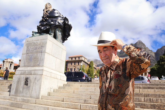 Activist and former Constitutional Court justice Albie Sachs next to the Rhodes statue on UCT upper campus. (Photo by Je'nine May.)