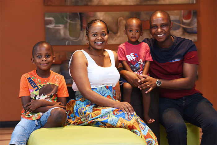 "Family support: Dr Disa Mogashana says her family were behind her every step of the way. Pictured with her, from left, are her sons Rese (6), Tumiso (2) and husband Lucky. ""My husband has been nothing else but a blessing. He's been supportive throughout,"" says Disa."