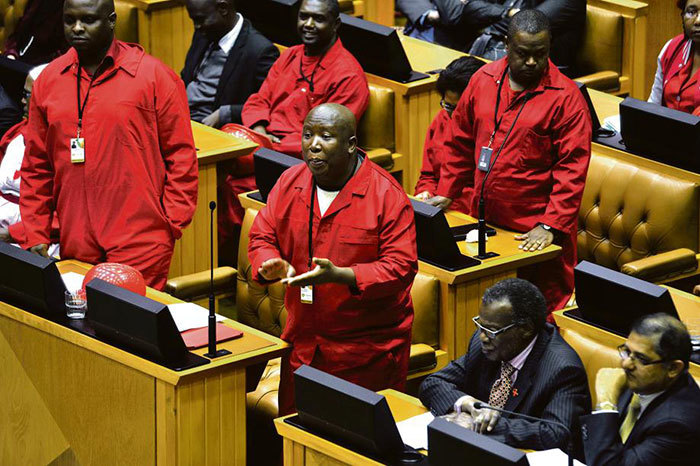 Leader of the Economic Freedom Fighters Julius Malema gets animated in his interaction with ANC MPs across the floor from him in the National Assembly.