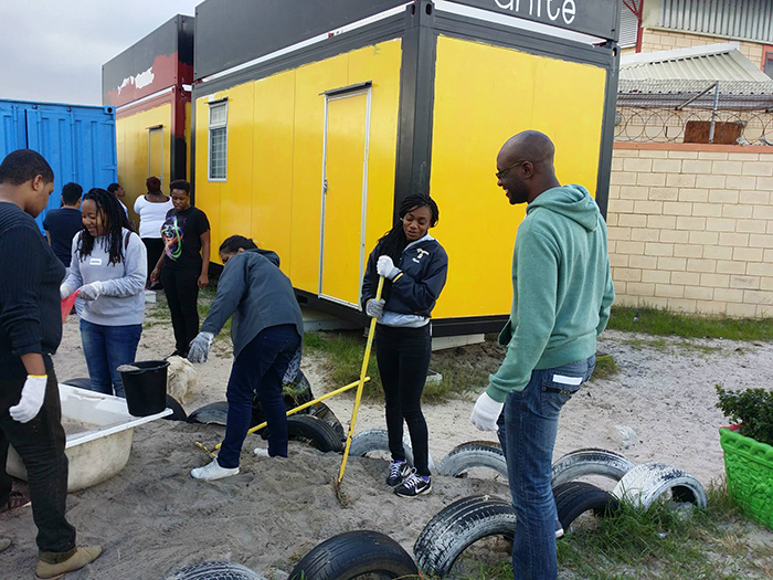 "Students of UCT's Global Citizenship Programme helping out at Mothers Unite in Lavender Hill. Founded in 2008 in a mother's home, <a href=""http://www.mothersunite.org.za/"" target=""_blank"">Mothers Unite</a> is something of a safe haven, where over 150 children have access to books, computers, art therapy, sports and play – as an alternative to the gangsterism they're witness to on the streets. Photo courtesy of the <a href=""http://www.facebook.com/UCTGlobalCitizen/"" target=""_blank"">UCT Global Citizen Facebook page</a>."