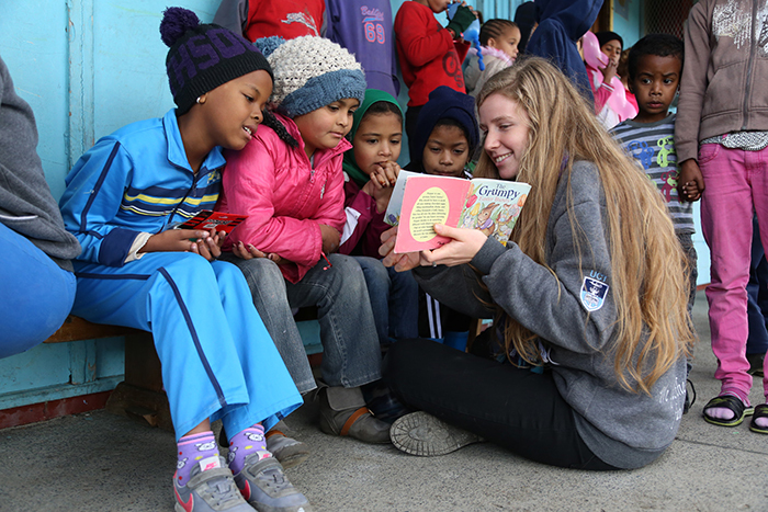 Open imagination: A UCT student attached to SHAWCO, the university's student-run community outreach initiative, reads to children in Manenberg, part of a programme to stimulate a love of reading. More than 1 000 UCT students are part of SHAWCO's community focused health and education projects, many run in the townships.