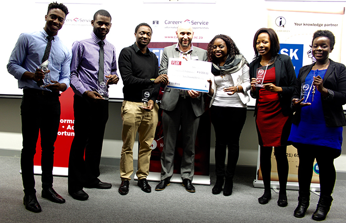 Winners of FLUX 2015 receive their prize of R9 000. They are from left Joshua Ojo-Aromokudu, Vogel Kayombo, Shingirayi Zimunhu, David Casey, director of UCT Careers Service, Ropafadzo Musvaire, Christabel Kunyongana and Michelle Chesa.