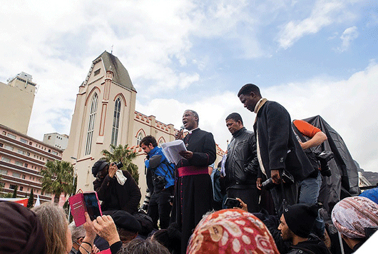 Archbishop Thabo Makgoba, who teaches a module on the GSB's Creating and Leading the Values-Driven Organisation, addresses the crowd at the recent anti-corruption march in Cape Town. Photo by Retha Ferguson.