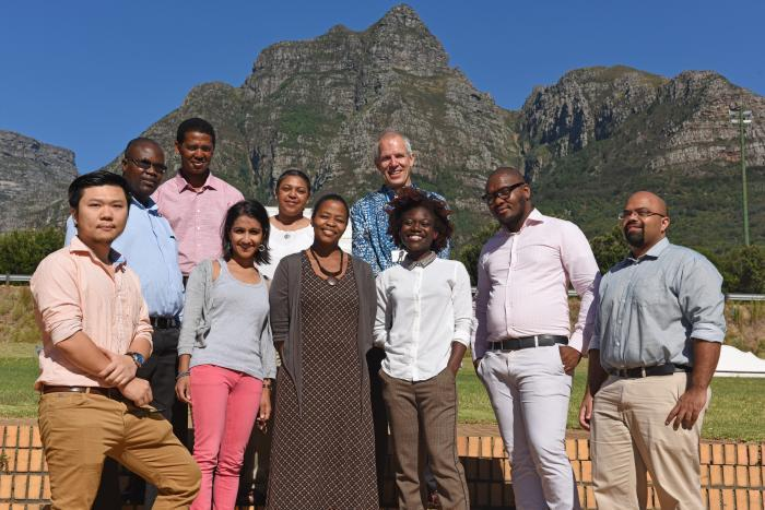 Cohort members: Front from left Chun-Sung Huang (Commerce), Ameeta Jaga (Commerce), Bongi Bangeni (CHED), Tolu Oni (Health Sciences), Nceba Lolwane (NGP administrator) and Reuben Govender (EBE) Back from left Joel Chigada (Commerce), Freedom Gumedze (Science), Heather Marco (Science) and Robert Morrell (NGP Director).