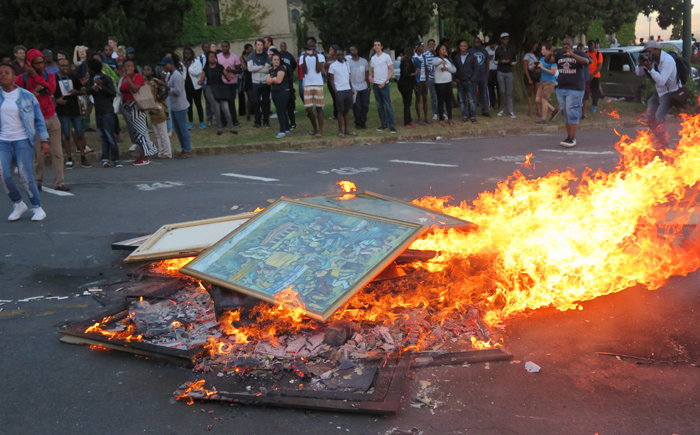 Protestors burning art on 16 February 2016 at UCT.