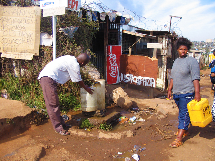 A communcal tap for drinking water in Soweto, Johannesburg. A study shows that poor communities feel that their concerns, such as the delivery of basic services, are not heard by the media unless they resort to violent protests.