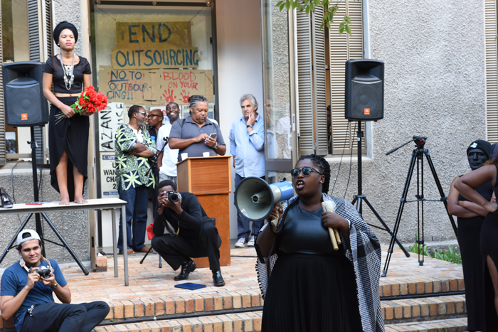 A Rhodes Must Fall leader addresses the crowd outside the CAS Gallery after an exhibition jointly curated by RMF and the Centre for African Studies was stopped by a group of protesting students.