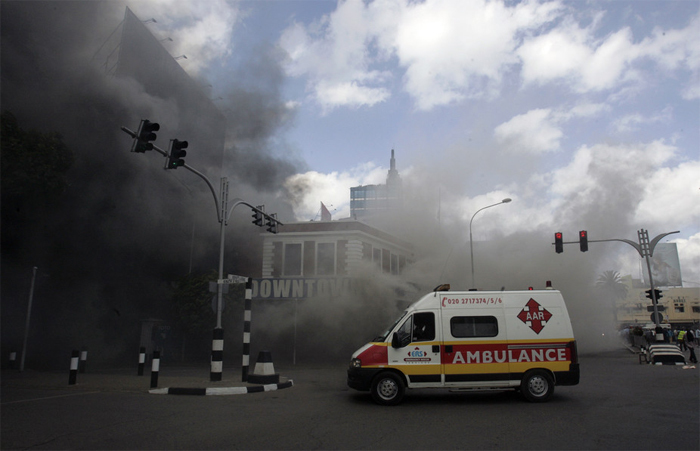 An ambulance arrives to evacuate casualties from a fire at the Nakumatt supermarket in Kenya. Reuters/Antony Njuguna.