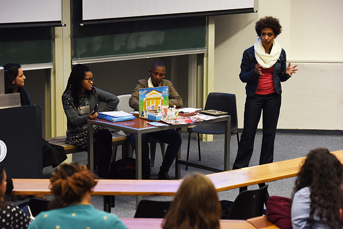 ​​​​​​​From left: Sianne Abrahams, Dela Gwala and Dr Zethu Matebeni unpacked UCT's response to sexual violence on campus at a forum organised by the Black Academic Caucus. Yaliwe Clarke, standing, chaired the discussion.