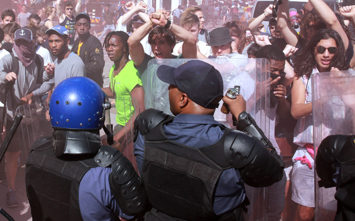 Student protesters clashed with police outside Parliament in Cape Town on 21 October 2015.