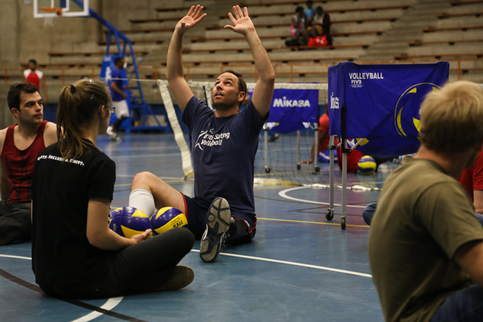 Raimondo demonstrates how to set a shot while keeping your pelvis rooted, as per the rules. Sitting volleyball debuted at the Toronto Paralympic Games as a demonstration sport for amputees and has been played as a medal sport since.