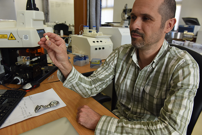 Dr Petrus le Roux, the head of geological sciences' radiogenic isotope laboratory, examines a molar that likely belonged to French artist Paul Gauguin.