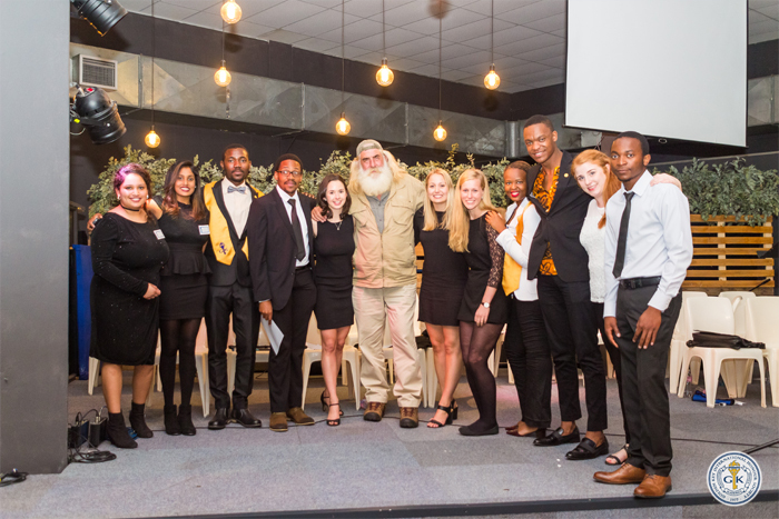 Kingsley Holgate with the UCT Golden Key Society committee members.