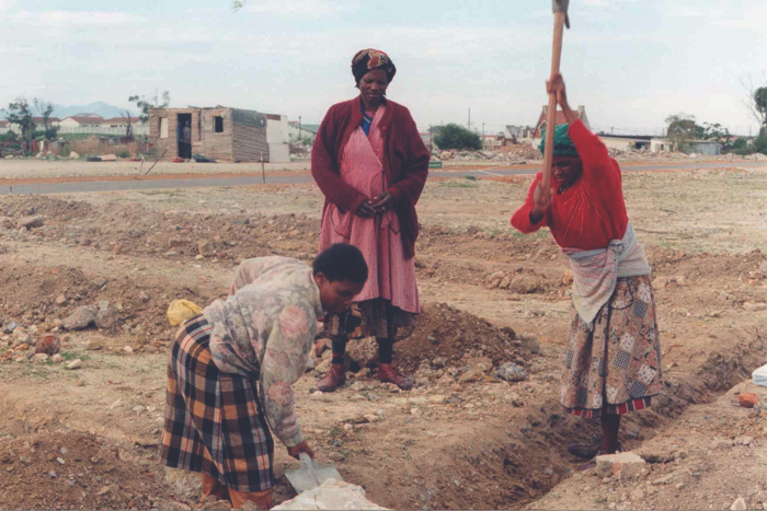 Women of Victoria Mxenge digging the first foundation.