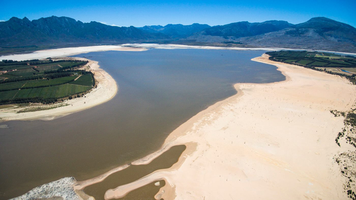 Extremely low levels of water currently in the Theewaterskloof Dam, the largest dam serving the City of Cape Town.