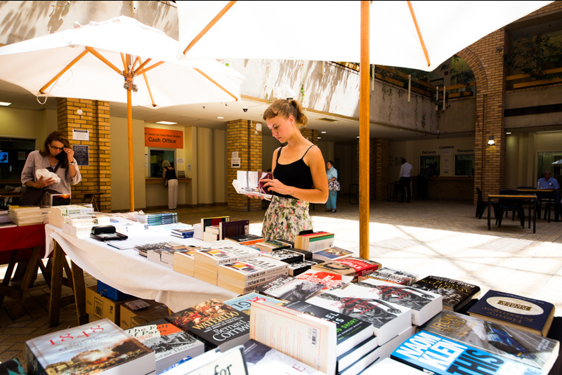 Attendees browse books for sale during Summer School.
