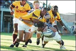 Crossing the line: Ashley Down (ball in hand), with Tyrone McFarlane lending support, goes over for one of UCT's six tries against Tygerberg.
