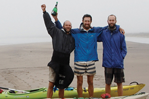 Source to sea: (From left) UCT's James Puttick, Sam Jack and Ian Durbach celebrate at the Orange River mouth, Atlantic Ocean, having completed their Senqu2Sea expedition, the first full-length ecological census of the river's vegetation and ecosystems. (Photo by Peter Jack.)