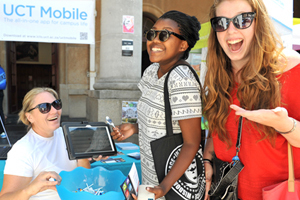 <b>Appsolute convenience:</b> Now the nifty new UCT Mobile application for smartphones and tablets allows students to - among other things - search for and reserve books, check the Jammie Shuttle timetable, and even check fee account balances. ICTS's Niki McQueen shows students Bobo Mthombeni (middle) and Jennifer Rackstaw (right), how it works.