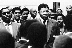 "By representing himself and using the Rivonia Trial as a ""showcase for the ANC's moral opposition to racism"" Nelson Mandela used an apartheid court of law as a channel for a political protest, fundamentally changing the relationship between law and politics in South Africa, says Carrol Clarkson. This image of Mandela is from the days of the Treason Trial in 1956. ©Photograph by Jürgen Schadeberg. Sourced from the University of Cape Town Libraries Special Collections."