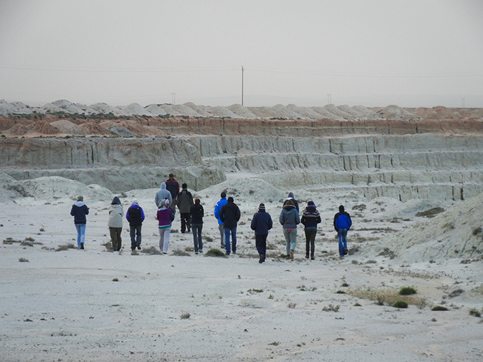 MSc students venture into a wasteland created by open-cast pit diamond mining along the Namaqualand coastline. They are part of the Namaqualand Restoration Initiative, a community-focused project to rehabilitate this fragile ecosystem. Image by Carina Bester.