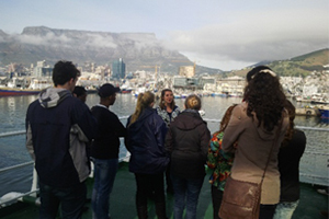 A UCT Oceanography PhD student guiding winter school students around the Agulhas II.