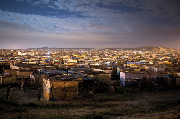 Light changing over Enkanini, on the far south-east side of Khayelitsha. Photo by David Harrison.