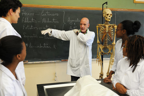 Teacher on the table: Prof Graham Louw with a group of second-year MBChB students in the dissection laboratory. Students dissect bodies donated to UCT, although some are unclaimed - those of the homeless, paupers or prisoners.