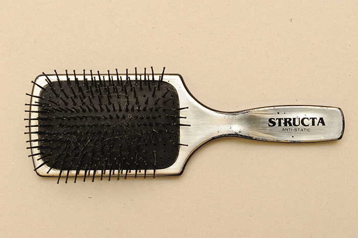 This hairbrush can be found among the many papers in this collection. Jack Simons loved to brush his wife's long hair.