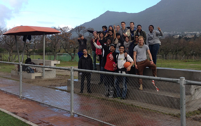 During the June 2015 vacation, architecture students along with key staff members and residents of Imizamo Yethu helped to build a watering point and seating platform for the football field. Photo supplied.