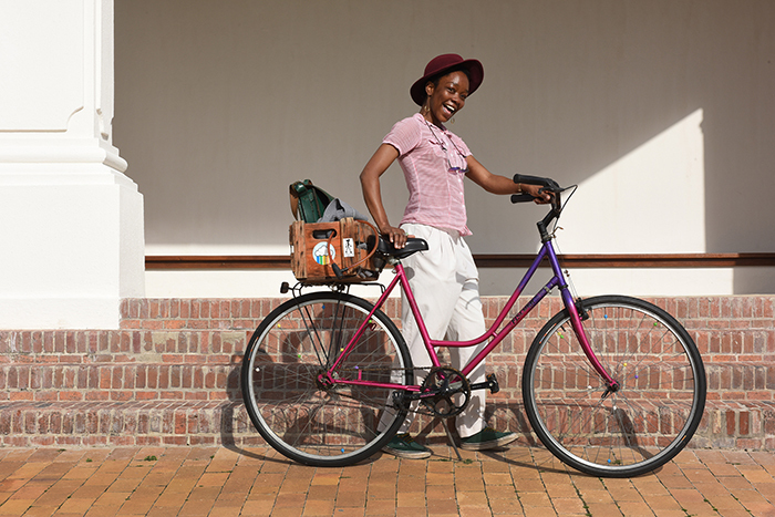 "Chaze Matakala, a film and media student, chose this bicycle because of its colour, ""Purple is my favourite colour,"" she says. Photo by Michael Hammond."