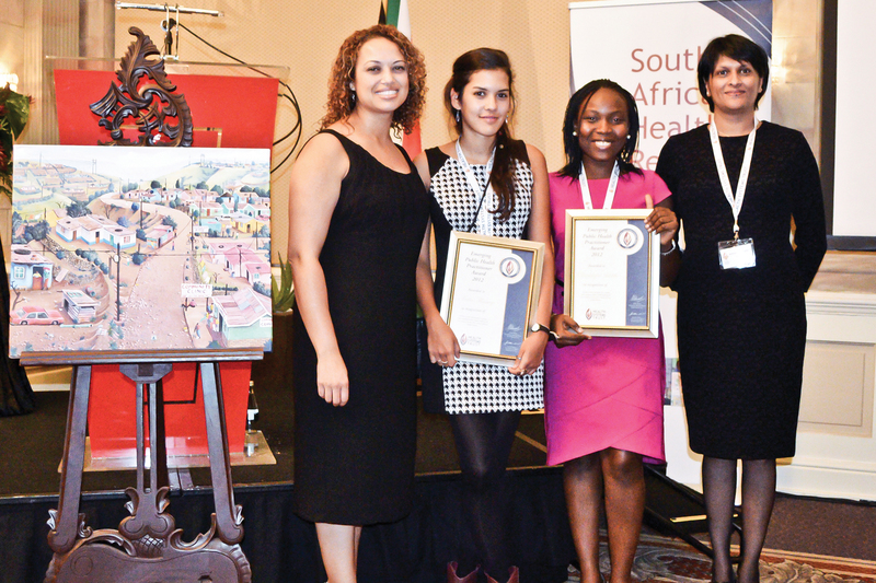 The winners of the Emerging Public Health Practitioners Award for 2012, Nadia Hussey and Oluwatoyin Adeleke, flanked by the editors of the South African Health Review, Rene English (on far left) and Ashme Padarath (far right).