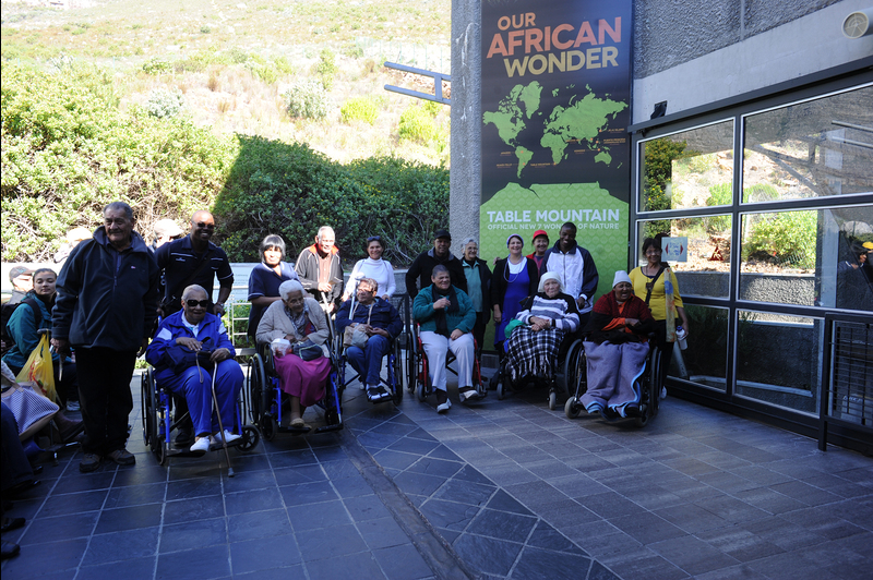 Up and away: Residents of Rehoboth Age Exchange and GH Starke homes for the aged in Hanover Park enjoyed a trip to the top of their world, thanks to UCT physiotherapy students and their supervisor in the Division of Physiotherapy, and the Table Mountain Aerial Cableway.