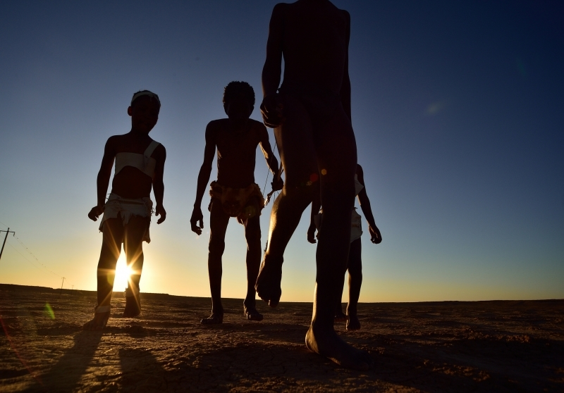 Elia Fester and children, Kalahari Khomani San Bushman, Boesmansrus camp, Northern Cape, South Africa.